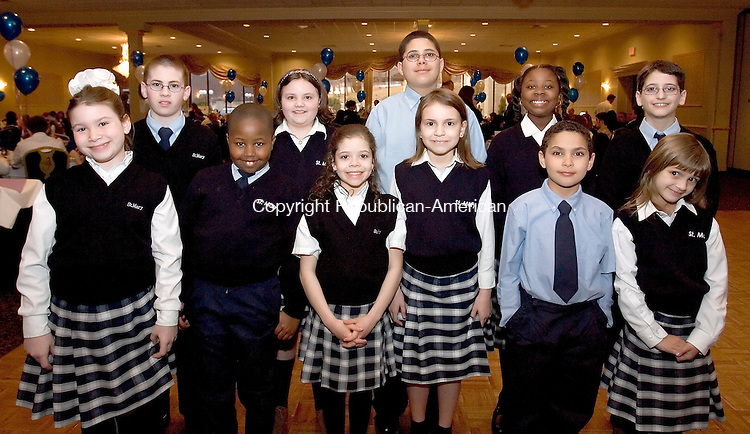 WATERBURY, CT--11 APRIL 2007--041107JS14-Student representatives from Saint Mary's School, front row from left, Emily Marold, Tevon Knight, Katherine Gomes, Rachael Perrinicchi, Ryan Pegurio and Olivia Pettinicchi. Back row, from left, Ian Riley, Alyssa Gaskin, Ysmael Peguera and Zhana Knight and Thomas Vella at the Bells of Saint Mary's annual awards dinner Wednesday at the Ponte Club in Waterbury. <br /> Jim Shannon / Republican-American