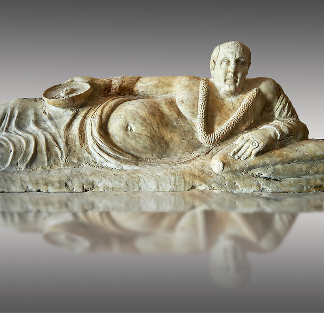Close up of an Etruscan Hellenistic style cinerary, funreary, urn cover with a man,  National Archaeological Museum Florence, Italy , against grey