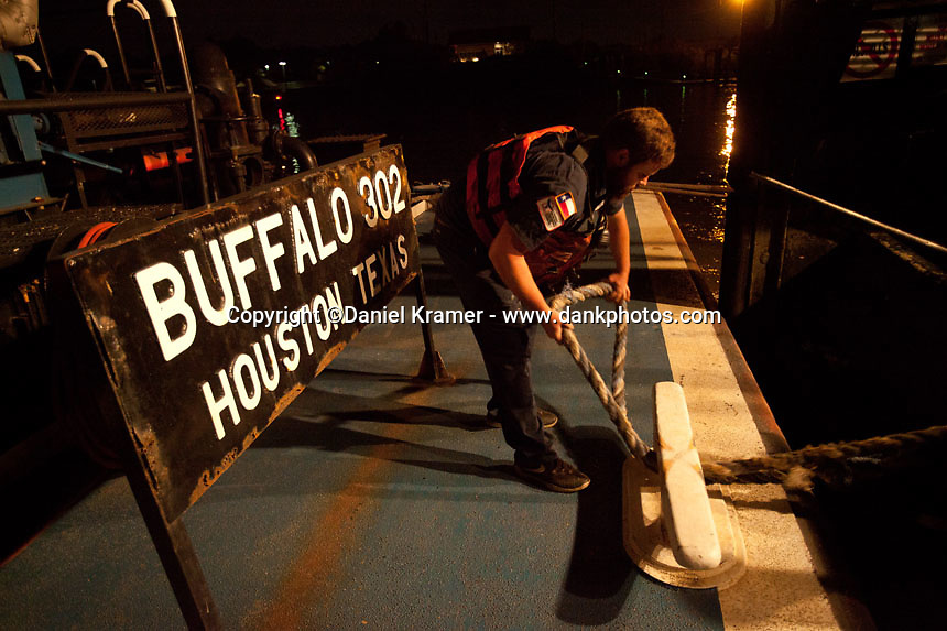 Buffalo Marine tankerman Terry Curow ties up a barge to be used in refueling the Oregon Highway on Friday, Nov. 11, 2016.