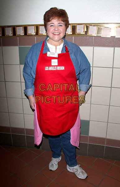 PATRIKA DARBO.L.A. Mission and Anne Douglas Center's Thanksgiving Meal For The Homeless held at The Los Angeles Mission, Los Angeles, California, USA..November 26th, 2008.full length red apron jeans denim blue shirt top.CAP/ADM/KB.©Kevan Brooks/AdMedia/Capital Pictures.