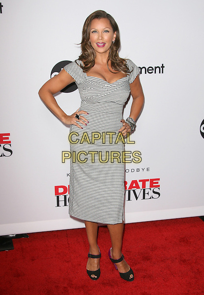 "Vanessa Williams.The ""Desperate Housewives"" Final Season Kick-Off Party held at Wisteria Lane in Universal Studios in Universal City, California, USA..September 21st, 2010.full length grey gray white black check dress hands on hips .CAP/RKE/DVS.©DVS/RockinExposures/Capital Pictures."