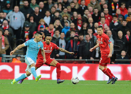 28.02.2016. Wembley Stadium, London, England. Capital One Cup Final. Manchester City versus Liverpool. Manchester City Forward Sergio Agüero knocks the ball forward into the Liverpool area, as Liverpool's Nathaniel Clyne and James Milner defend