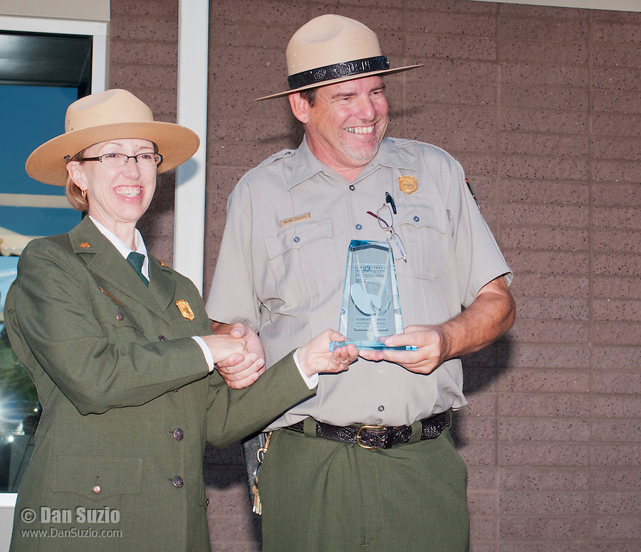 Park Superintendent Sarah Craighead presents an award to Wayne Badder at the Grand Re-Opening of the Furnace Creek Visitor Center in Death Valley National Park, California, on November 4, 2012.