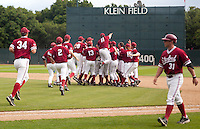 STANFORD, CA - April 23, 2011: The Stanford baseball team celebrates their victory after Stanford's game against UCLA at Sunken Diamond. Stanford won 5-4.
