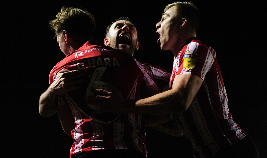 Lincoln City's Mark O'Hara, left, celebrates scoring the opening goal with team-mates Neal Eardley, centre, and Harry Anderson<br /> <br /> Photographer Chris Vaughan/CameraSport<br /> <br /> The EFL Sky Bet League Two - Lincoln City v Yeovil Town - Friday 8th March 2019 - Sincil Bank - Lincoln<br /> <br /> World Copyright © 2019 CameraSport. All rights reserved. 43 Linden Ave. Countesthorpe. Leicester. England. LE8 5PG - Tel: +44 (0) 116 277 4147 - admin@camerasport.com - www.camerasport.com
