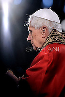 Pope Benedict XVI holds the wooden cross during the Via Crucis (Way of the Cross) torchlight procession on Good Friday in front of the Colosseum in Rome.April 6, 2012