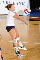 24 September 2010:  FIU's Angelina Colon (4) saves the ball in the third set as the FIU Golden Panthers defeated the University of Denver Pioneers, 3-0 (29-27, 25-16, 25-20), at U.S Century Bank Arena in Miami, Florida.