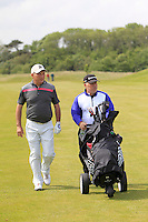 John Garvey (Seapoint) and his caddy on the 6th during Round 1 of the Irish Amateur Close Championship at Seapoint Golf Club on Saturday 7th June 2014.<br /> Picture:  Thos Caffrey / www.golffile.ie