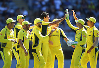 Mitchell Starc and team mates celebrate the wicket of Latham.<br /> International One Day Cricket. Chappell&ndash;Hadlee Trophy, Game 1. Eden Park Monday 30 January 2017 &copy; Copyright photo: Andrew Cornaga / www.photosport.nz