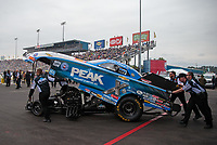 Mar 17, 2019; Gainesville, FL, USA; Crew members push the car of NHRA funny car driver John Force during the Gatornationals at Gainesville Raceway. Mandatory Credit: Mark J. Rebilas-USA TODAY Sports