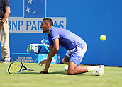 June 19th 2017, Queens Club, West Kensington, London; Aegon Tennis Championships, Day 1; Nick Kyrgios of Australia falls to the ground as he injured himself attempting to play a forehand