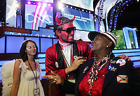8/27/08 1:09:00 PM -- Denver, CO, U.S.A. -- Democratic National Convention -- .Delegate Kat Gordon, of Orlando, FL, laughs with devil Toby Crittended, of Seattle, WA, as angle Carrie Jackson, of Denver, CO, watches on the floor of the Pepsi Center before Wednesday's DNC. .Photo by Pat Shannahan, Gannett.