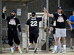 POWAY, CA - JULY 16:  Safety Eric Weddle and Quarterback Philip Rivers of the San Diego Chargers congratulated teammates who scored runs during the Regular Joe League at the Poway Sportsplex Softball Field on July 16, 2014 in Poway, California. (CREDIT: Donald Miralle for the Wall Street Journal) <br /> chargers