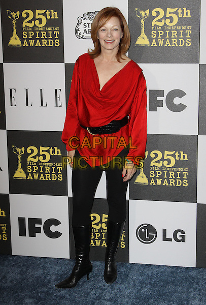 FRANCES FISHER .25th Annual Film Independent Spirit Awards held At The Nokia LA Live, Los Angeles, California, USA,.March 5th, 2010 ..arrivals Indie Spirit full length red top black waist belt leggings boots knee high .CAP/ADM/KB.©Kevan Brooks/Admedia/Capital Pictures