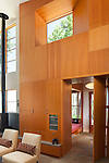 A wood wall with built-ins separates the living room and entry of a contemporary island home. This image is available through an alternate architectural stock image agency, Collinstock located here: http://www.collinstock.com