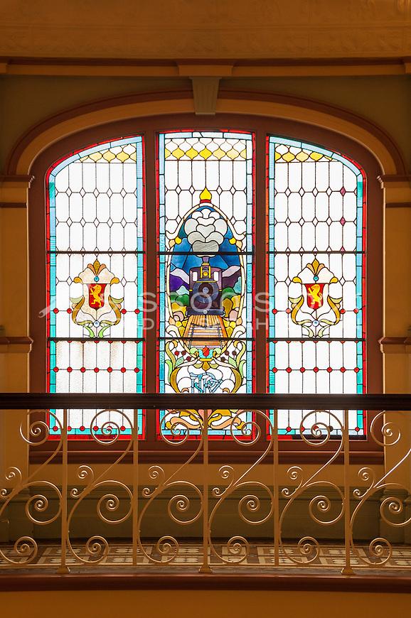Stained Glass window with train motif at the Dunedin Railway Station, Otago, New Zealand - stock photo, canvas, fine art print
