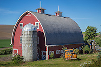 An old red barn location outside of Colfax Washington in the Palouse reagion.
