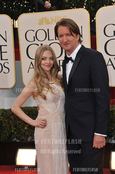 Amanda Seyfried & Tom Hooper at the 70th Golden Globe Awards at the Beverly Hilton Hotel..January 13, 2013  Beverly Hills, CA.Picture: Paul Smith / Featureflash