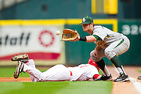 First baseman Max Muncy #9 of the Baylor Bears waits for a pick off throw as Landon Appling #1 of the Houston Cougars dives back to the base at Minute Maid Park on March 4, 2011 in Houston, Texas.  Photo by Brian Westerholt / Four Seam Images