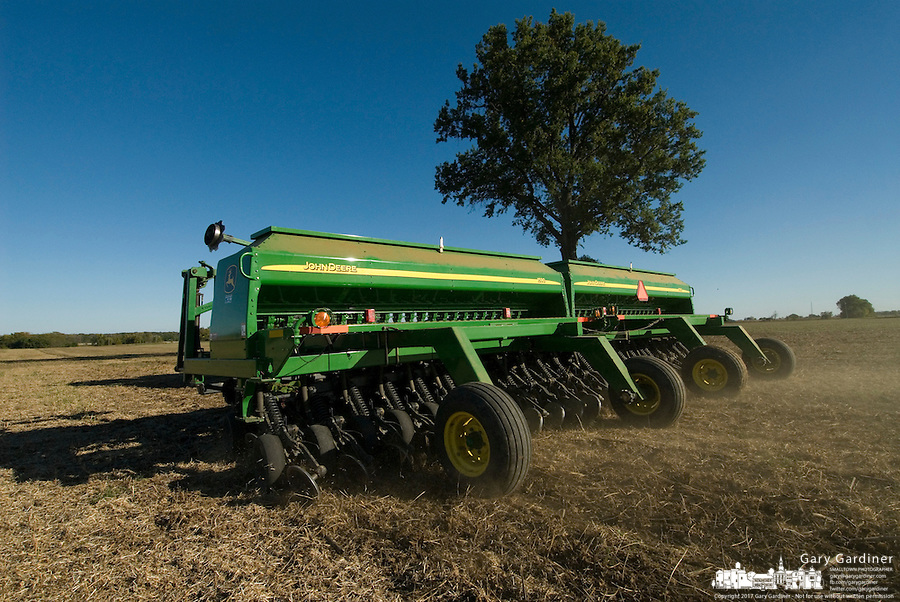 A farmer plants winter wheat seeds after harvesting soybeans near Jones, Ohio.<br />