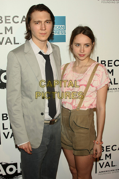"""PAUL DANO & ZOE KAZAN .attends the 10th Anniversary Edition of the Tribeca Film Festival - Opening Night Gala Premiere of """"The Union"""" at the Winter Garden of the World Financial Center, New York, NY, USA, .20th April 2011..half  length pink t-shirt braces shorts beige brown suit tie jacket grey gray white shirt   lederhosen .CAP/LNC/TOM.©LNC/Capital Pictures."""