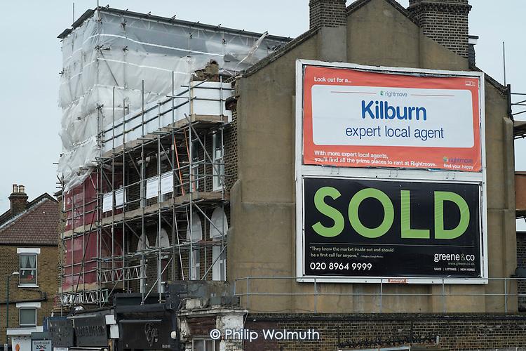 Ads for online estate agent Rightmove and Greene & Co, Kilburn, London.