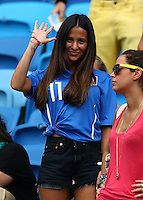 Federica Riccardi, the fiancee of Alessio Cerci of Italy waves to photographers before kick off