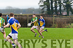 Colm Galvin, Lispole, gets past Jake Mehigan, Ballyhooly, during their sides clash in the Munster Junior B club football final in Knockaderry