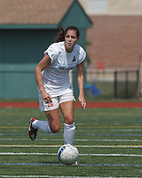 Boston Aztec defender Jessica Morrow (26) brings the ball forward.  In a Women's Premier Soccer League (WPSL) match, Boston Aztec (white) defeated Seacoast United Mariners (blue), 2-1, at North Reading High School Stadium on Arthur J. Kenney Athletic Field on on June 23, 2013. Due to injuries through the season, Seacoast United Mariners could only field 10 players.