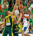 "France`s Tony Parker (R) and Robertas Javtokas (15) and Martynas Pocius of Lithuania in action during European basketball championship ""Eurobasket 2013""  final basketball game between France and Lithuania in Stozice Arena in Ljubljana, Slovenia, on September 22. 2013. (credit: Pedja Milosavljevic  / thepedja@gmail.com / +381641260959)"