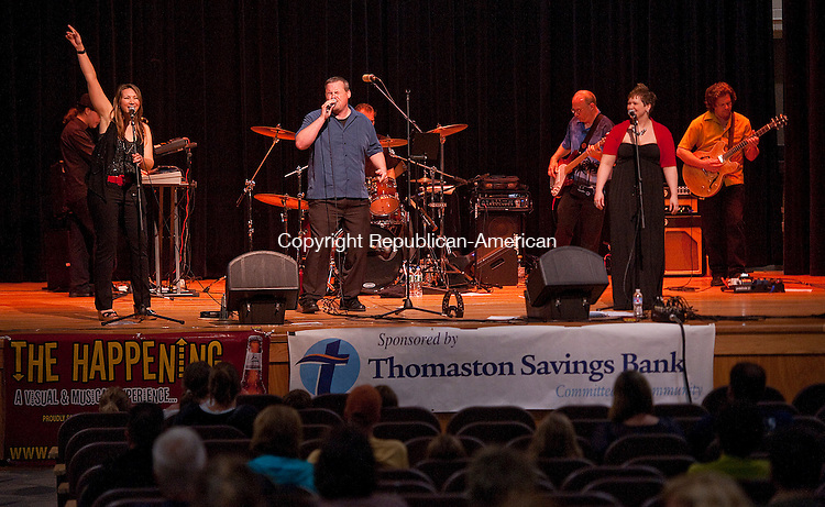 THOMASTON, CT 01 JULY 2013--070113JS05- The Happening plays on stage at Thomaston High School on Monday as part of the free Summer Concert Series produced by the Fine Arts Connection of Thomaston. The concert, normally played at Seth Thomas Park, was moved to the high school because of the rain. The concert series continues next week July 8, with the cutting-edge acoustic country band Goldrush. The concert begins at 7 p.m. <br /> Jim Shannon Republican American