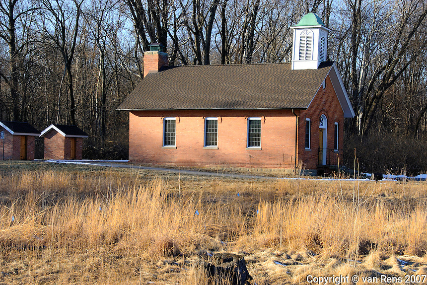 Restored red brick schoolhouse symbolic of basic and classic American education