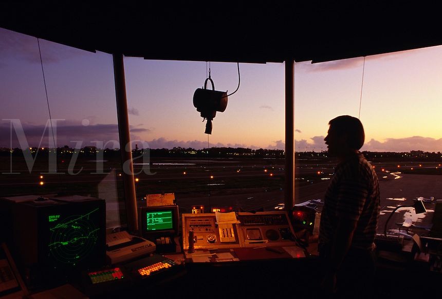 Air traffic controller [ATC] directing aircraft movement