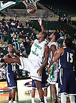 North Texas Mean Green forward George Odufuwa (4) scores a basket  in the game between the Jackson State Tigers and the University of North Texas Mean Green at the North Texas Coliseum,the Super Pit, in Denton, Texas. UNT defeated Jackson 68 to 49