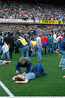 Chaos at the Leppings Lane End as 94 fans are crushed to death, The Hillsborough Disaster, Liverpool v Notts Forest, FA Cup Semi-Final, 890415. Mike Hewitt/Action Plus...1989.soccer.football.tragedy.crowd.crowds.supporters.fans.spectators