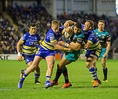 2nd February 2019, Halliwell Jones Stadium, Warrington, England; Betfred Super League rugby, Warrington Wolves versus Leeds Rhinos; Kallum Watkins is tackled strongly by Jack Hughes