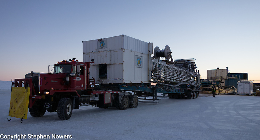 A Cruz Construction haul truck prepares to unload the derrick on a Linc Energy ice pad in Umiat, Alaska, during the 2013-2014 winter season. Cruz Construction provided rig support for Linc Energy's drilling program in Umiat.