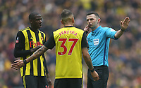 Referee Michael Oliver in discussion with Watford's Abdoulaye Doucoure and Roberto Pereyra<br /> <br /> Photographer Rob Newell/CameraSport<br /> <br /> Emirates FA Cup Semi-Final  - Watford v Wolverhampton Wanderers - Sunday 7th April 2019 - Wembley Stadium - London<br />  <br /> World Copyright © 2019 CameraSport. All rights reserved. 43 Linden Ave. Countesthorpe. Leicester. England. LE8 5PG - Tel: +44 (0) 116 277 4147 - admin@camerasport.com - www.camerasport.com