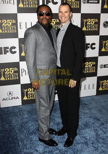 LEE DANIELS & GUEST .25th Annual Film Independent Spirit Awards held At The Nokia LA Live, Los Angeles, California, USA,.March 5th, 2010 ..arrivals Indie Spirit full length black suit  grey gray sunglasses .CAP/ADM/KB.©Kevan Brooks/Admedia/Capital Pictures