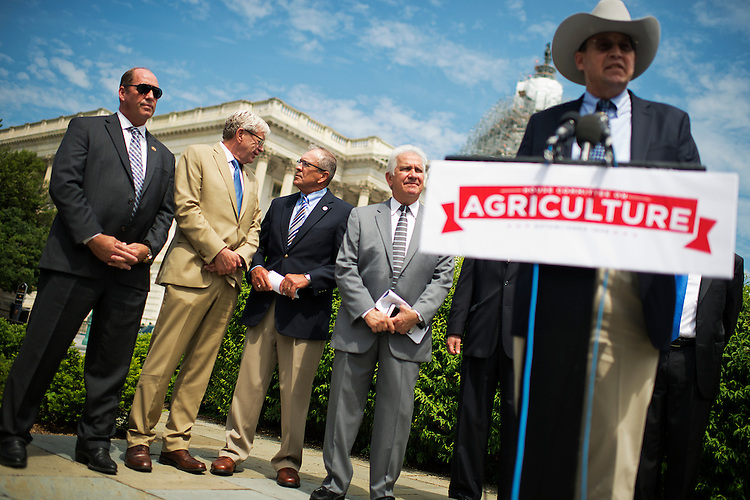 UNITED STATES - MAY 19: From left, Reps. Ted Yoho, R-Fla., Brad Ashford, D-Neb., John Weber, president-elect of the National Pork Producers Council, Rep. Jim Costa, D-Calif., and Philip Ellis, president of the National Cattleman Beef Association, attend a news conference at the House triangle to push for repeal of the country-of-origin labeling (COOL) requirements for meat products, May 19, 2015. (Photo By Tom Williams/CQ Roll Call)