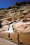 UT: Utah; Capitol Reef National Park, Children playing in Fremont River, model released.     .Photo Copyright: Lee Foster, lee@fostertravel.com, www.fostertravel.com, (510) 549-2202.Image: utcapi202