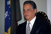 President Fernando Henrique Cardoso of Brazil with the Brazilian flag behind.