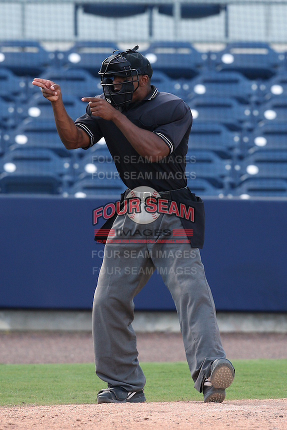 Home plate umpire Javerro January during an Instructional League game between the Tampa Bay Rays and Minnesota Twins at Charlotte Sports Park in Port Charlotte, Florida;  October 5, 2010.  Photo By Mike Janes/Four Seam Images