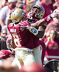 Ermon Lane, right, celebrates with Nyquan Murray after Murray scored on a 51 yard pass reception in the first half of an NCAA college football game against Syracuse in Tallahassee, Fla., Saturday, Nov. 4, 2017. Florida State defeated Syracuse 27-24.  (AP Photo/Mark Wallheiser)