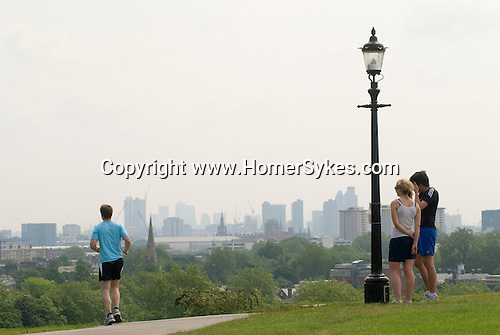 Mid adults keep fit jog top of Primrose Hill. London UK 2008