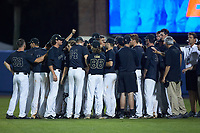 The Wake Forest Demon Deacons huddle around head coach Tom Walter following their loss to the Florida Gators in Game Three of the Gainesville Super Regional of the 2017 College World Series at Alfred McKethan Stadium at Perry Field on June 12, 2017 in Gainesville, Florida. The Gators defeated the Demon Deacons 3-0 to advance to the College World Series in Omaha, Nebraska. (Brian Westerholt/Four Seam Images)