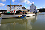 Historic boat and Tide Mill on the waterfront, River Deben, Woodbridge, Suffolk, England, UK