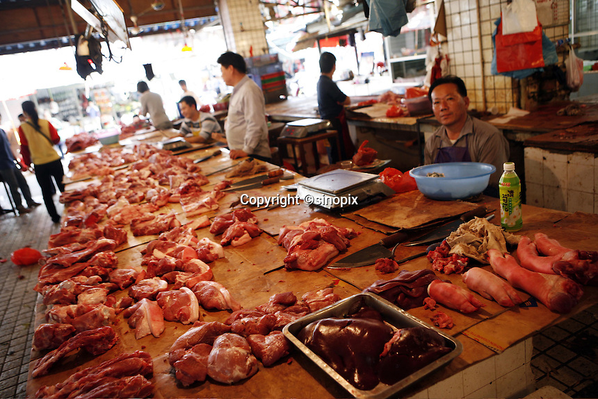 Cuts of pork for sale in the Futian agriculture and produce market.<br />