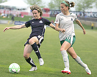 Sonia Bompastor #8 of the Washington Freedom makes a pass in front of Angie Woznuk #11 of St. Louis Athletica during a WPS match at the Maryland Soccerplex on May 3, 2009 in Boyds Maryland. The game ended in a 3-3 tie.