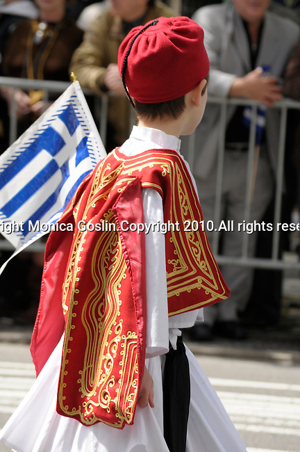 Greek Parade in New York City. A boy in tradational clothes (red and white) and holding a Greek flag in the Greek Parade in New York City.